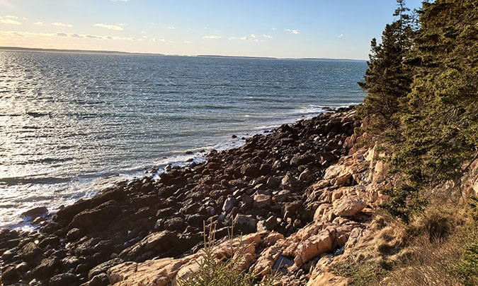 rocky shores and water by the bass harbor lighthouse