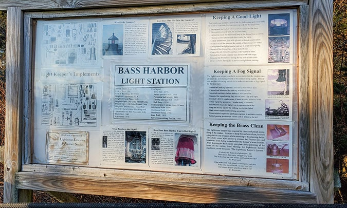 newspaper clippings of the bass harbor lighthouse framed for tourists
