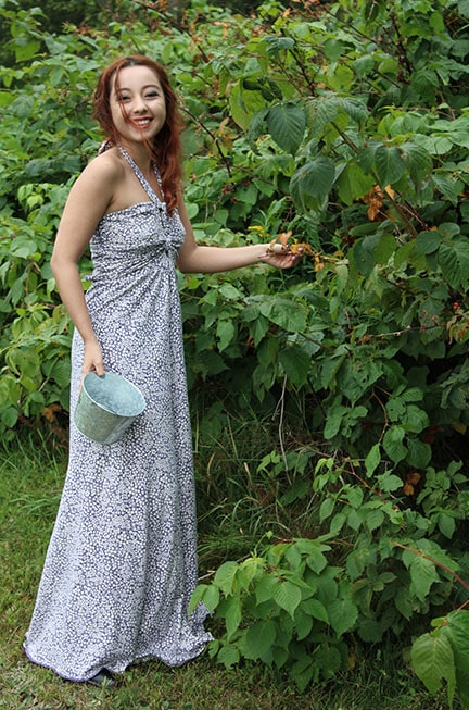 Geeves smiling as she picks blueberries in Maine