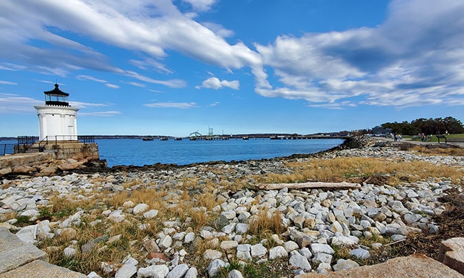 panoramic view of bug lighthouse and rocky shore