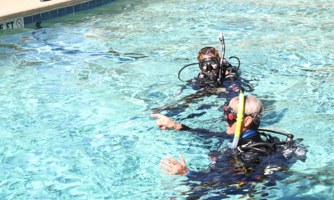 Geeves and scuba instructor in Devil's Den Swimming pool