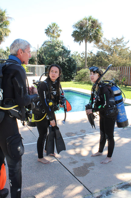 Geeves, sister, and scuba instructor in scuba gear