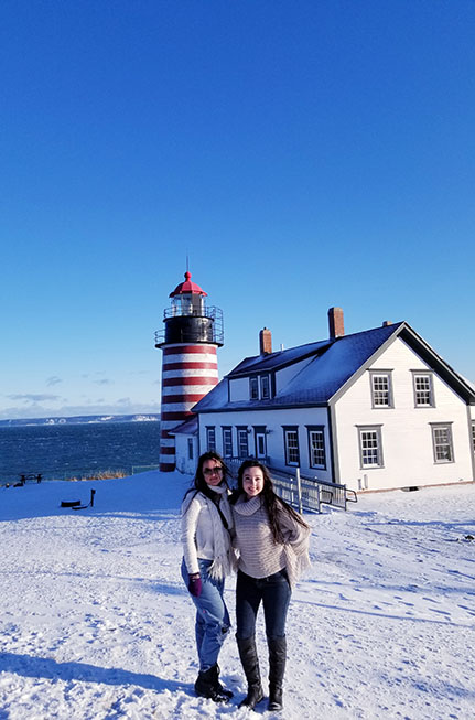 geeves and her sister posing in front of West Quoddy Lighthouse Lubec Maine