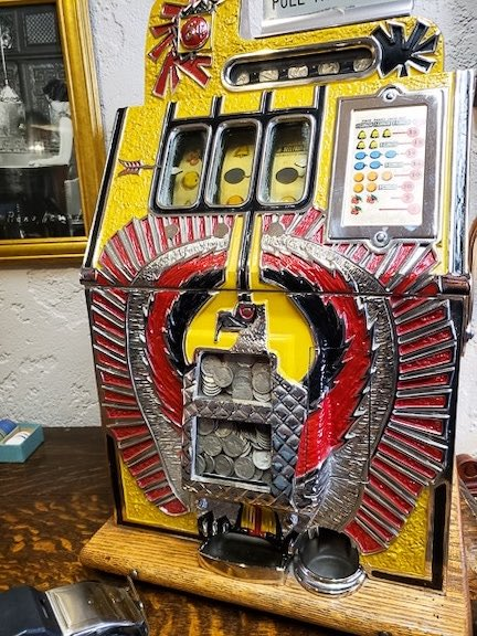 Yellow and red antique slot machine