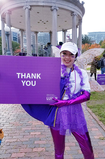 Geeves at Lupus walk holding a thank you sign