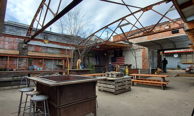 inside an old auto body shop turned brewery