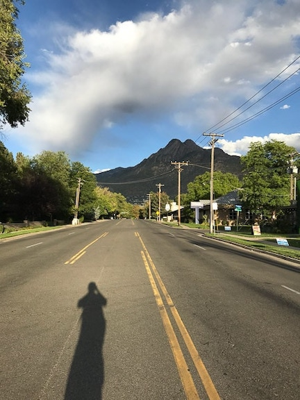 A long road in salt lake city with a mountain view