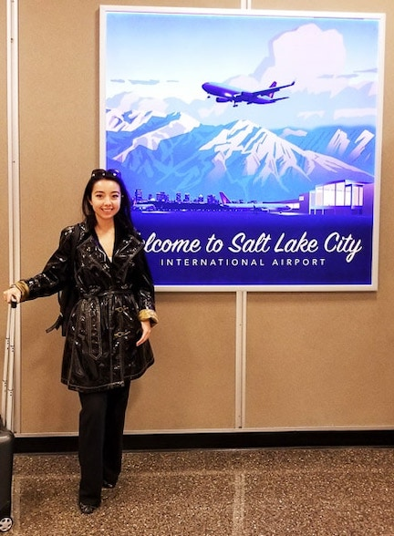 Geeves posing with salt lake city sign