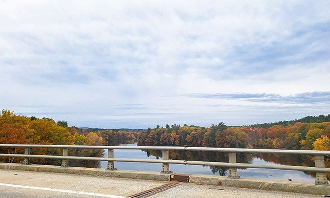 view of river and fall foliage