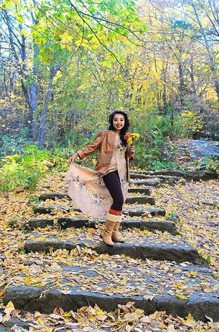 geeves posing in a path with fall leaves at her feet