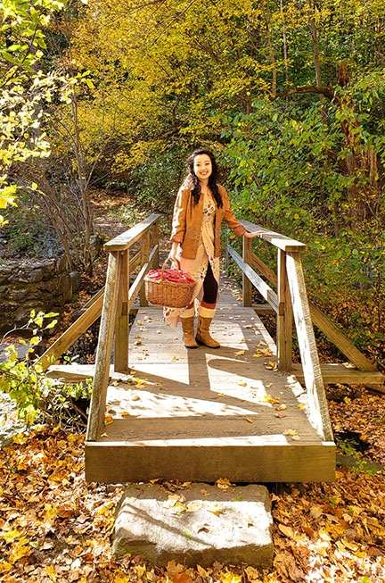 geeves standing on a bridge holding picnic basket